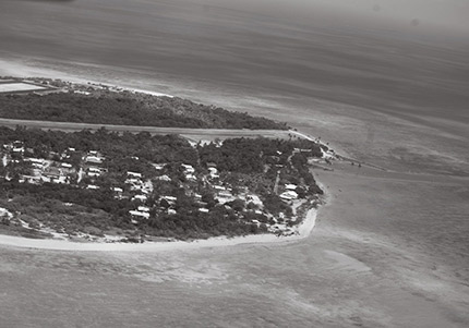 An aerial photo of an island showing a village