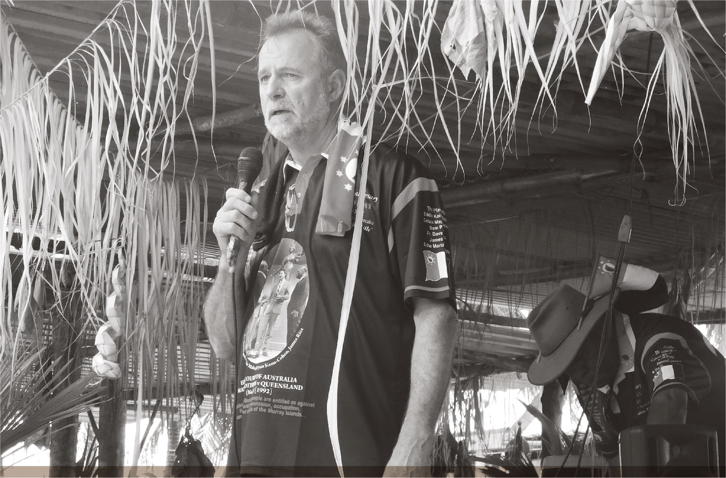 a photo of INDIGENOUS AFFAIRS MINISTER SENATOR THE HON. NIGEL SCULLION GIVING A SPEECH AT THE MABO DECISION 25TH ANNIVERSARY CELEBRATIONS ON MER.