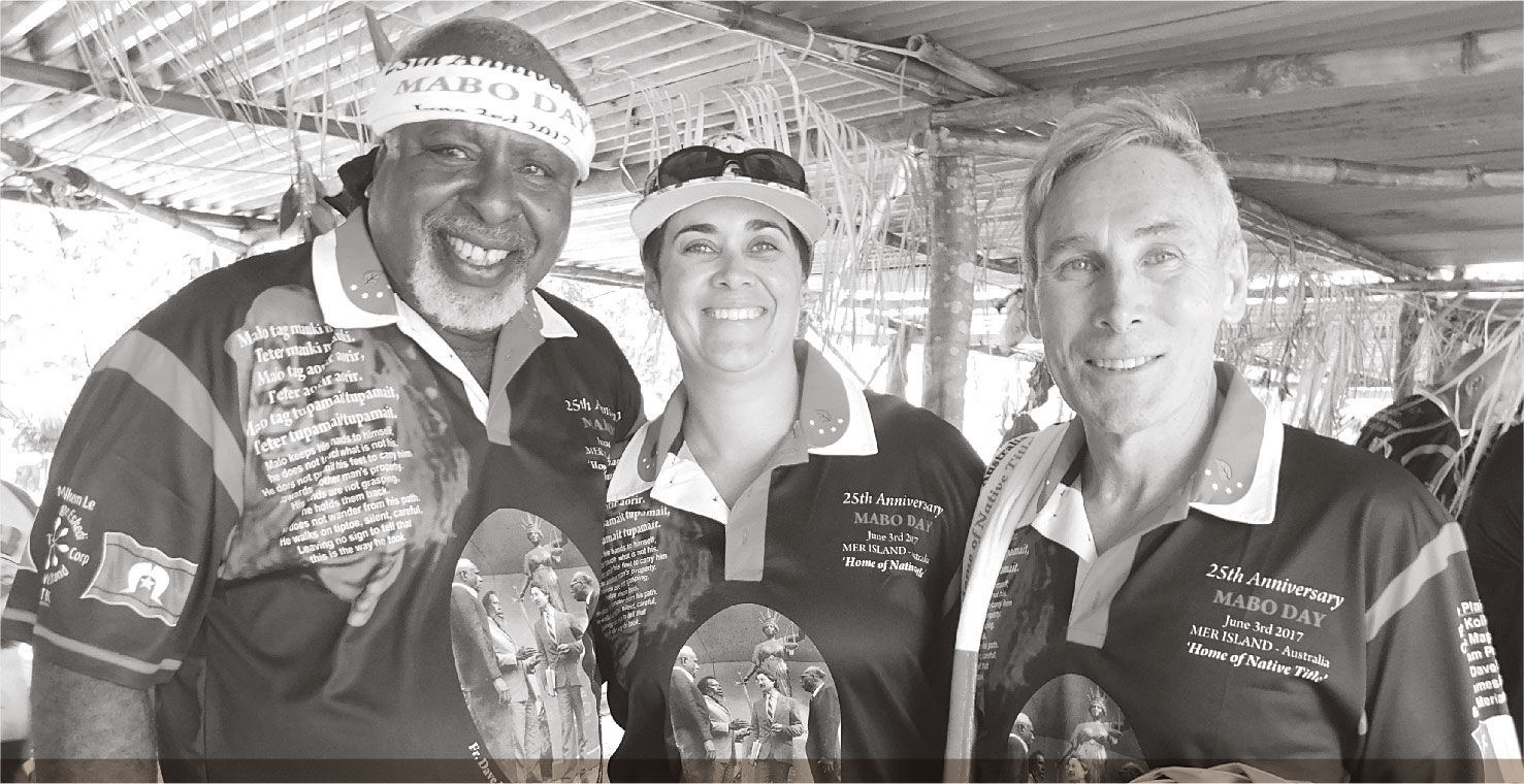 a photograph of DOUG PASSI, CHAIR OF MER GEDKEM LE (TSI) CORPORATION, CASSIE LANG, SENIOR LEGAL OFFICER TSRA NATIVE TITLE OFFICE, AND GREG MCINTYRE QC, SOLICITOR TO MABO PLAINTIFFS.