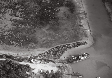 An aerial photo of a jetty on an island