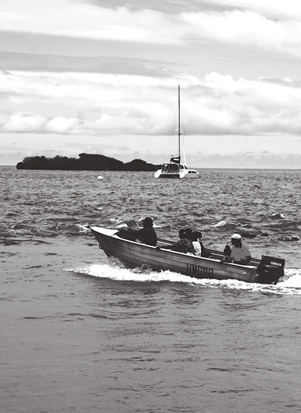 A photograph showing people commuting between Thursday and Hammond islands
