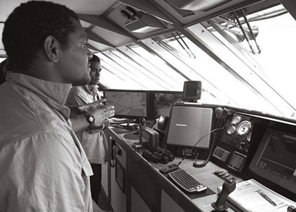 A photograph showing maritime training inside the bridge of a ship