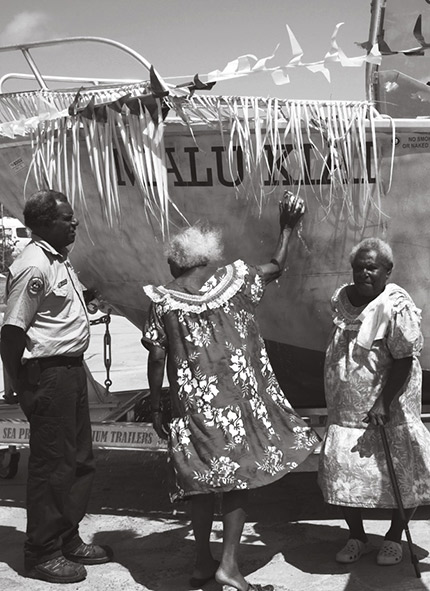 A photograph showing Torres Strait people blessing a ranger boat blessing on Boigu Island