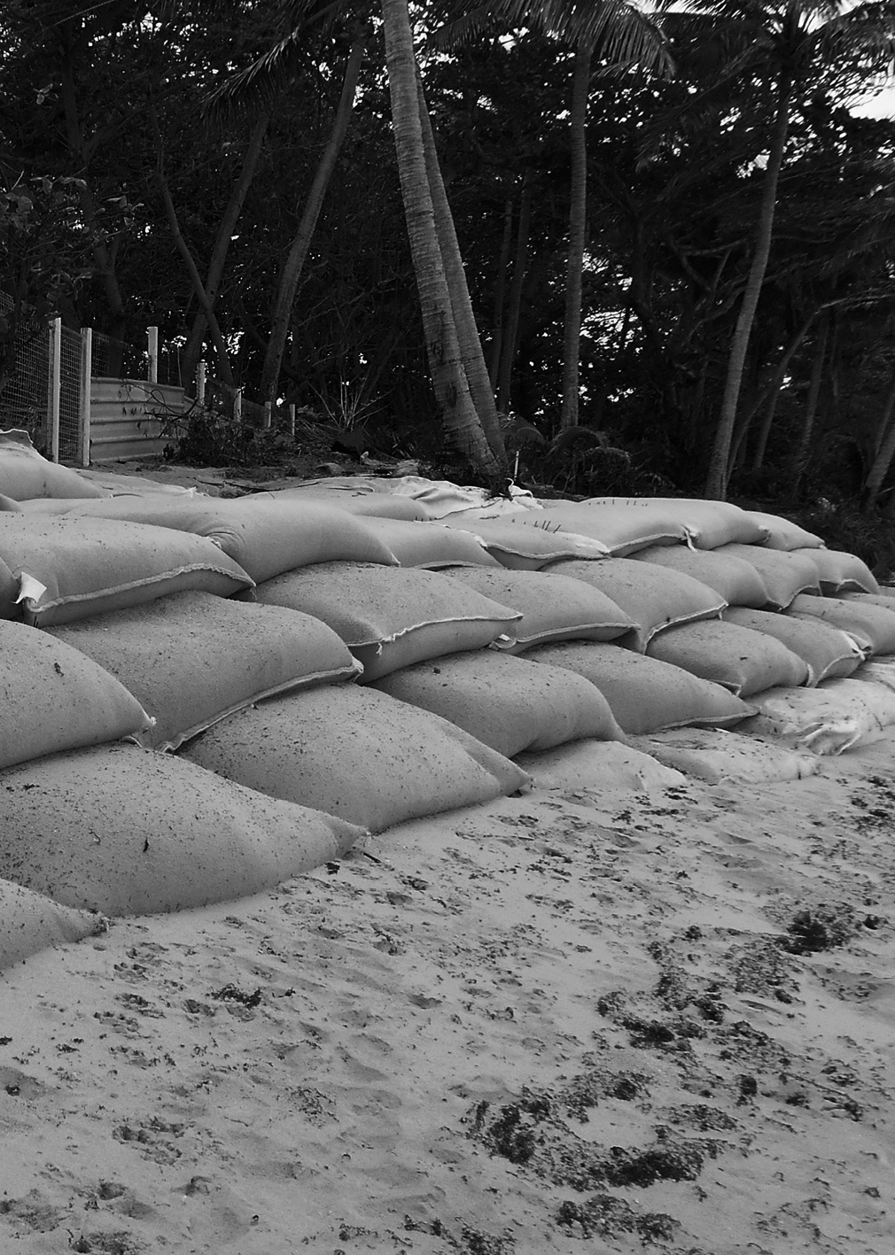A photograph of Poruma, sandbags for erosion protection